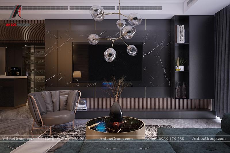 Tivi được gắn trên bức tường ốp đá tự nhiên cùng kệ gỗ sơn phủ màu đen
