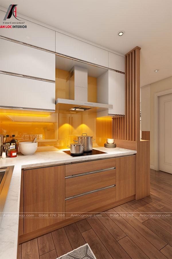 Không gian bếp nổi bật với tủ bếp chữ L kết hợp mảng ốp tường vàng nổi bật