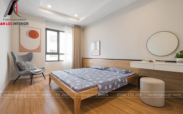 Phòng ngủ đơn giản với giường ngủ, tranh treo tường
