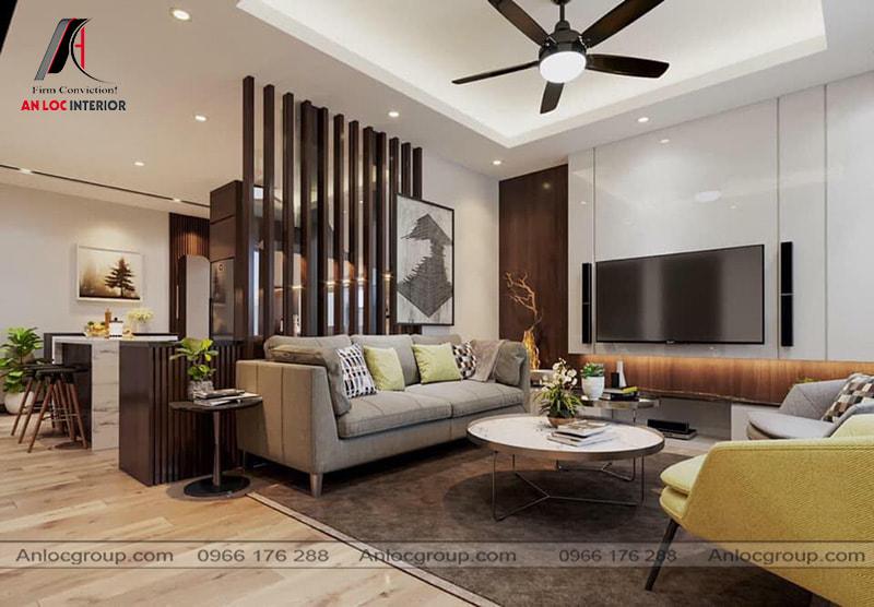 Mẫu 35 - Phòng khách chung cư nhỏ đẹp, một bức vách gỗ ngăn cách phòng khách và bếp