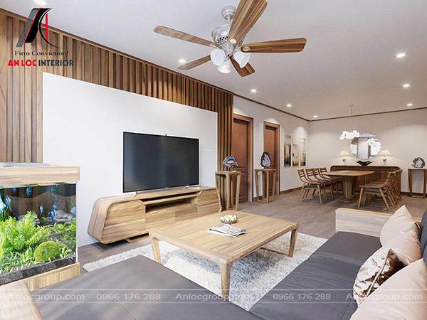 Mầu vân gỗ làm nổi bật không gian phòng khách của thiết kế chung cư 100m2. Điều này không tạo cảm giác nhức mắt mà mang đến ấn tượng độc đáo