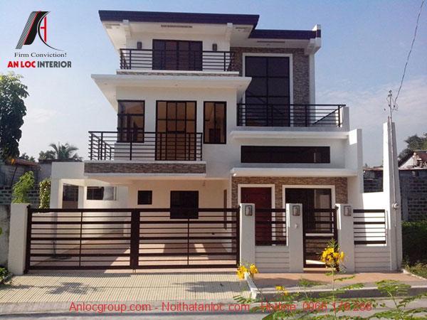 Nhà 3 tầng hiện đại với các hình khối chắc chắn và màu sắc kết hợp tinh tế