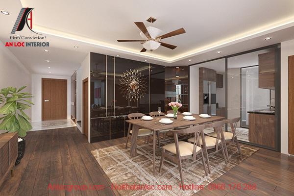 Phòng ăn và khu vực bếp rộng rãi được ngăn cách với phòng khách bởi vách kính màu đen