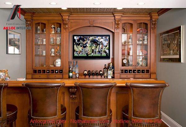 Màu sắc vân gỗ trong quầy bar tạo nên không gian hienẹ đại, tinh tế