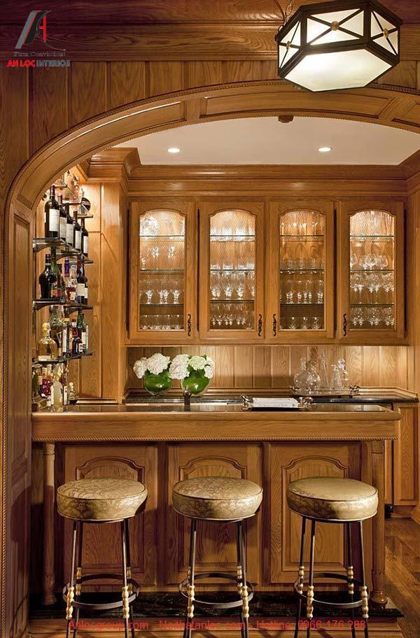Mẫu quầy bar đẹp kết hợp tủ đựng ly tạo nên sự pha trộn màu sắc độc đáo